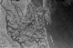 Image from Huygens as it decended 16km above Titans surface, showing the